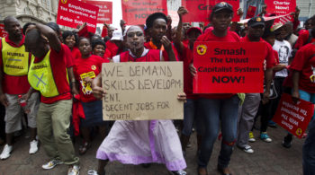 Members of the National Union of Metal Workers of South Africa (NUMSA) protest as they march through Durban, March 19, 2014. South Africa's largest union called for a one day strike on Wednesday to highlight youth unemployment in the country, where one in four people are jobless, the union said. The 340,000-member NUMSA draws its members from car manufacturing, the metal industry, transport and general workers. REUTERS/Rogan Ward (SOUTH AFRICA - Tags: BUSINESS POLITICS EMPLOYMENT INDUSTRIAL CIVIL UNREST) - RTR3HQNL