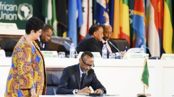 Rwandan President Paul Kagame, chairman of the African Union, signs the African Continental Free Trade Area agreement in Kigali, Rwanda, on March 21. (AP)